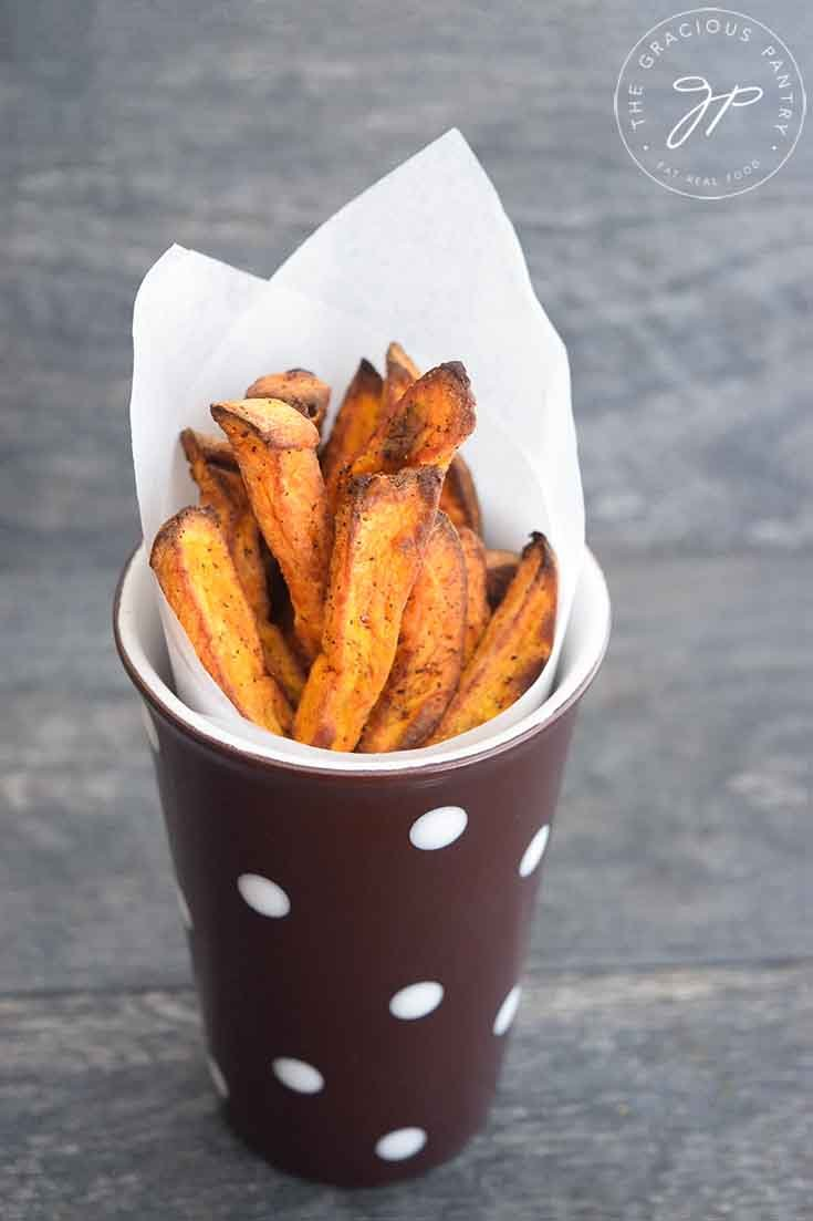 Finished Sweet Potato Fries Recipe, served in a polkadot cup.