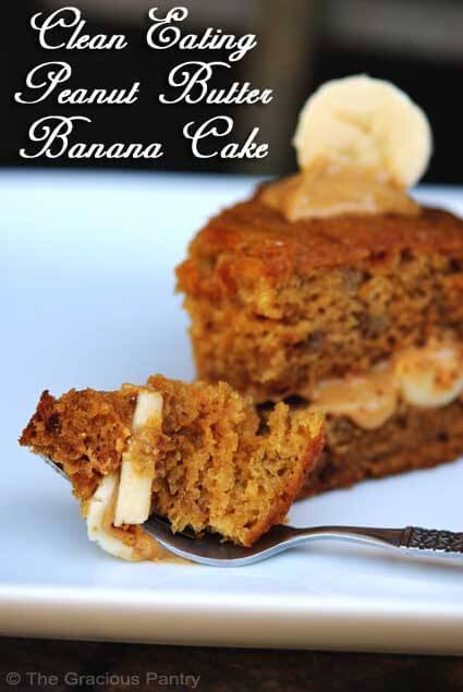 A slice of Peanut Butter Banana Cake sits on a white plate, garnished with some peanut butter and sliced bananas.