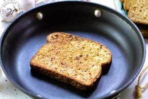 Step three of this Healthy French Toast Recipe shows a single piece of french toast, cooking in a skillet.