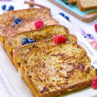 Four slices of Healthy French Toast are laid out on a serving platter, ready to eat.
