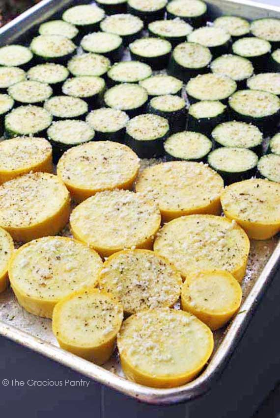 roasted squash and zucchini placed on a baking pan