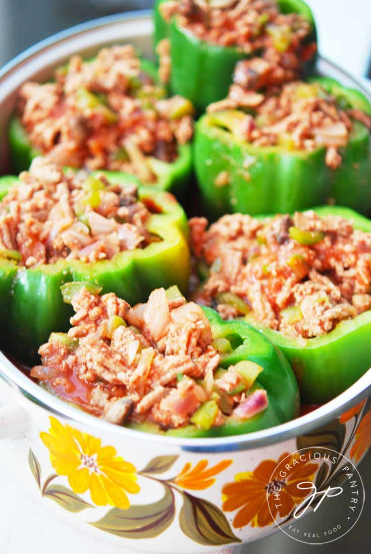 Clean Eating Stuffed Bell Peppers sitting in a pot, stuffed and ready to bake in the oven.