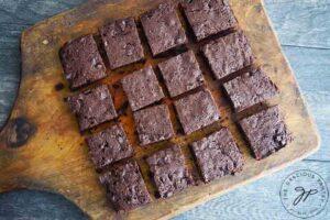 The freshly cut brownies, still sitting on the cutting board.