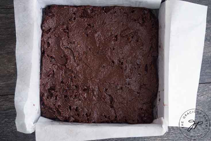 The batter for this Healthy Brownies Recipe spread evenly over the pan.