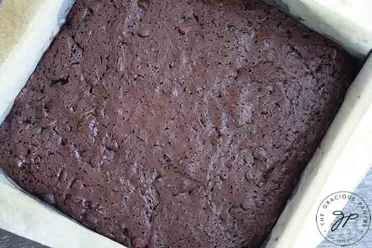 The baked brownies fresh out of the oven and still in the pan.