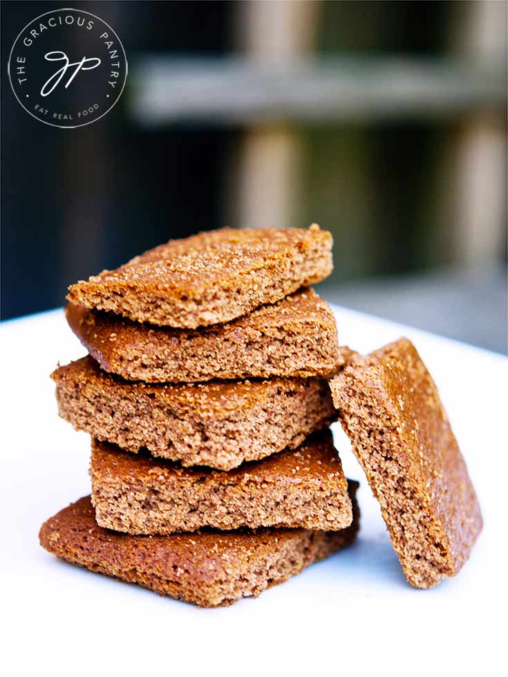 A stack of these Graham Cracker Cookies sit on a white platter, ready to eat.
