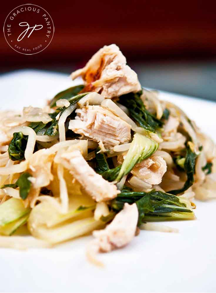 A serving of this Chicken Bok Choy Recipe sits on a white plate, ready to serve.