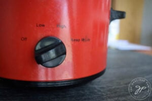 Switching slow cooker to warm setting.