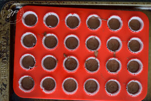 First layer of chocolate in muffin papers.