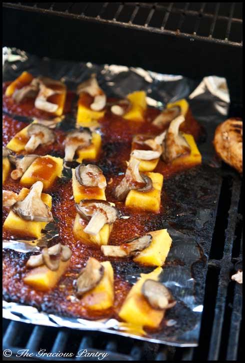 Arrange the mushrooms on top of the polenta pieces.