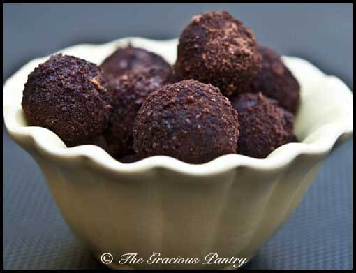 A yellow bowl filled with Clean Eating Jum Jills that have been coated in cocoa powder and date sugar.