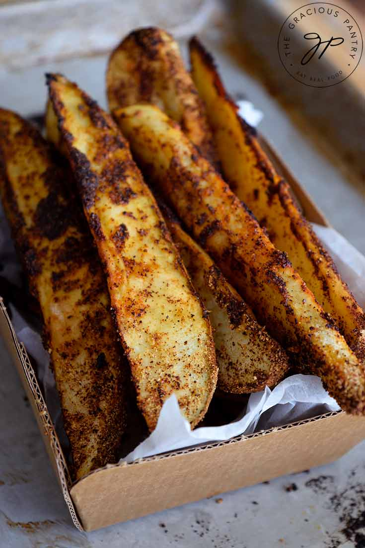 Delicious, golden brown Potato Wedges fresh out of the oven and ready to enjoy.