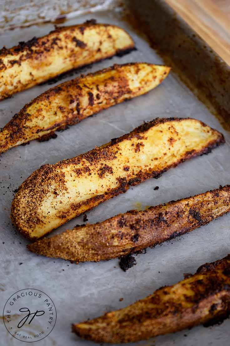 Potato Wedges, hot on a baking pan, golden brown out of the oven.