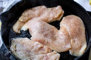Step three shows the chicken breasts in the skillet, ready to cook.