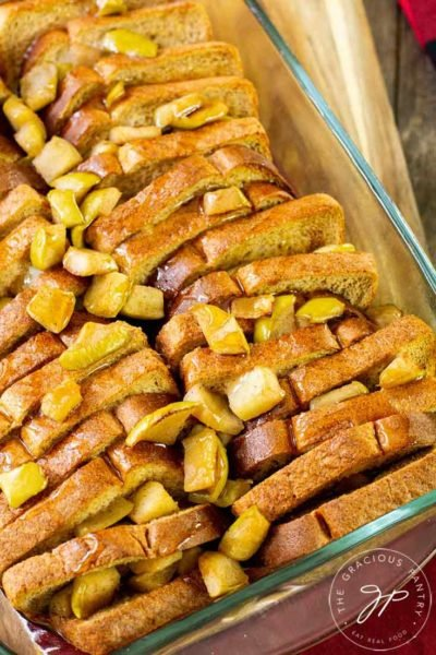 This Apple French Toast Casserole freshly out of the oven and topped with maple syrup.