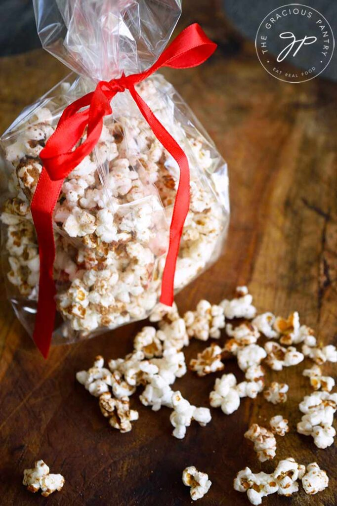 Kettle corn packaged in a clear plastic bag and tied with a red ribbon.