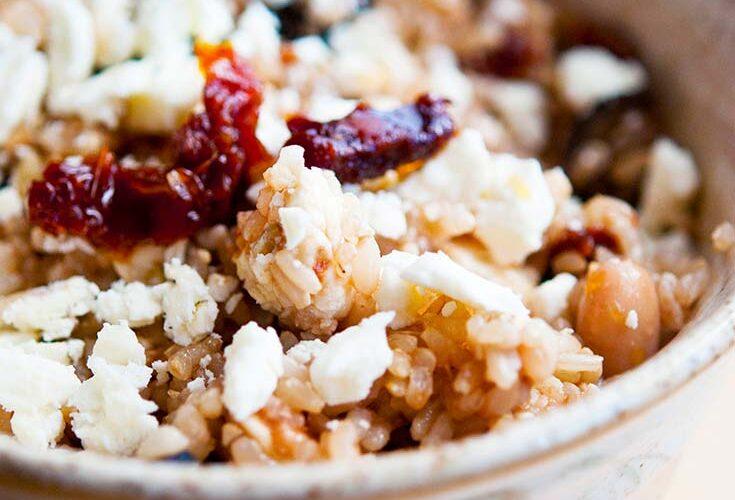 A single Greek Rice Bowl sits ready to eat.