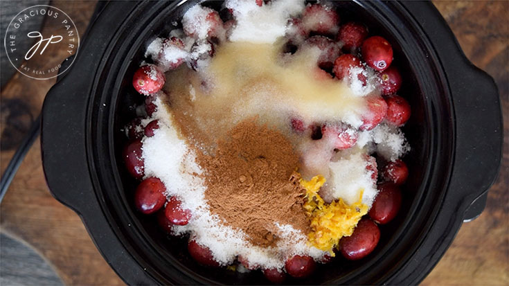 All ingredients added to a small slow cooker in this Crock Pot Cranberry Sauce recipe.