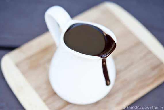 Clean Eating Coconut Fudge Sauce recipe displayed in a white pitcher, ready to enjoy over pancakes, waffles or ice cream.