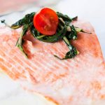Clean Eating Baked Salmon with Roasted Garlic & Lemon Sauce