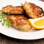 Clean Eating Tuna Patties on a white plate with lemon wedge