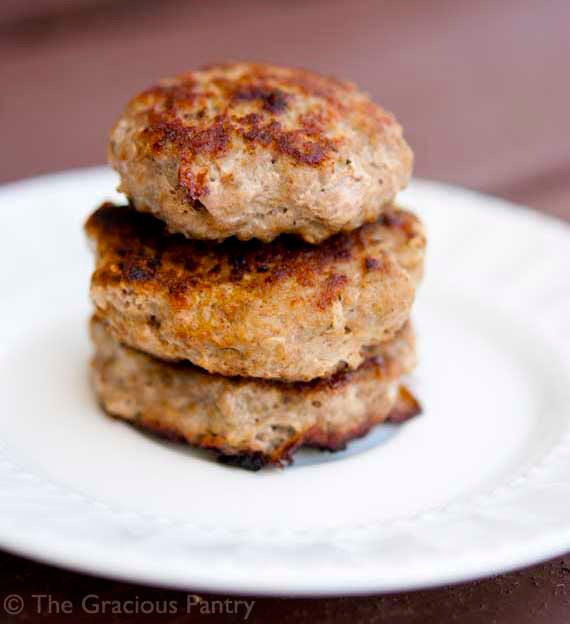 3 patties of homemade turkey breakfast sausage stacked on white plate