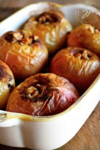 A pan of baked apples sits warm out of the oven, ready to serve.