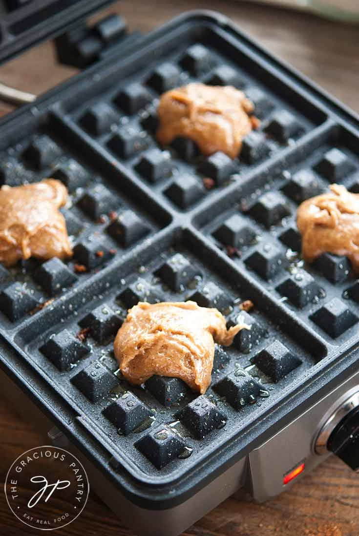 Place dollops of dough in the center areas of the waffle squares on your waffle iron.
