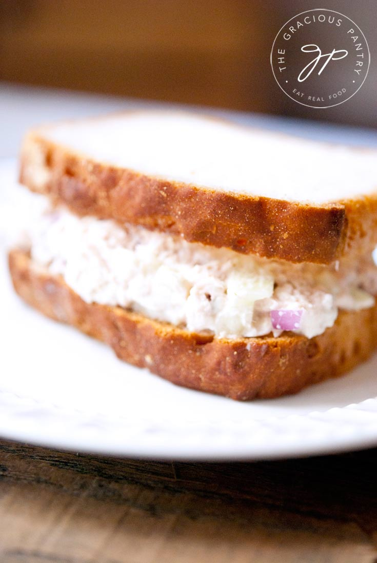 close view of a plated Tuna Fish Sandwich made with two slices of whole grain bread.