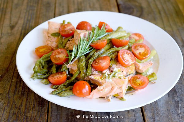 Clean Eating Pressure Cooker Mediterranean Rosemary Salmon served on a white plate and ready to enjoy.