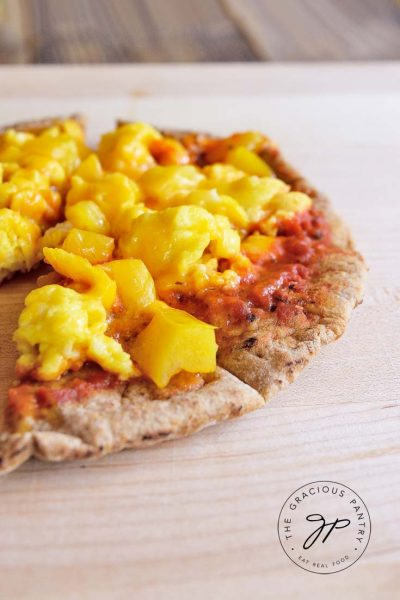 Clean Eating Scrambled Egg And Cheddar Breakfast Pita Pizza Recipe