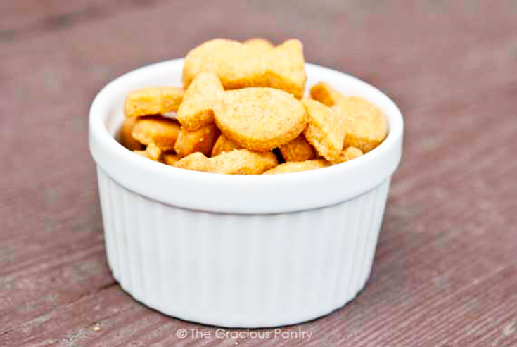 Homemade goldfish crackers in a small, white bowl.