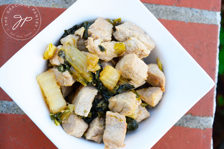 Looking down from overhead at a bowl of Clean Eating Asian Style Pork Bok Choy