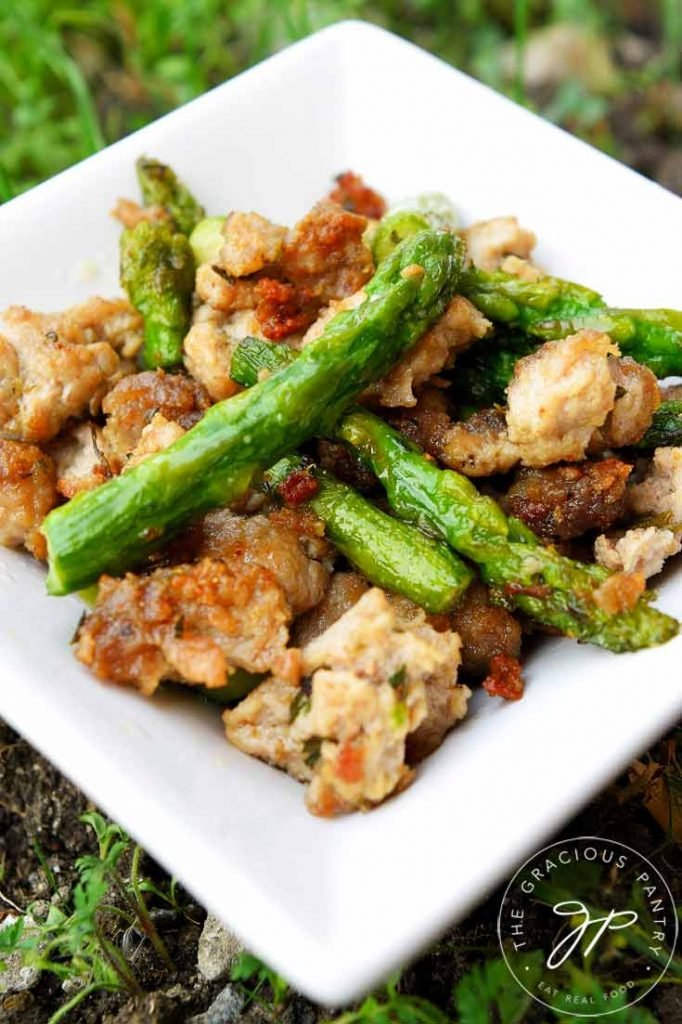 Ground Turkey dinner with asparagus spears in white dish