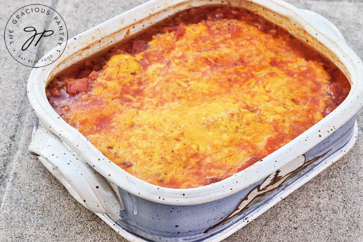 Clean Eating Cheesy Mexican Chicken Casserole Recipe shown in a casserole dish before being cut or served.