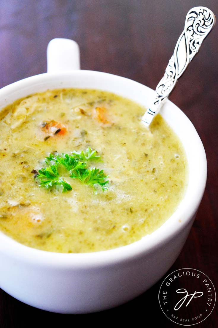 Clean eating instant pot chicken soup the gracious pantry clean eating instant pot chicken soup recipe shown up close in a white mug with a forumfinder Choice Image