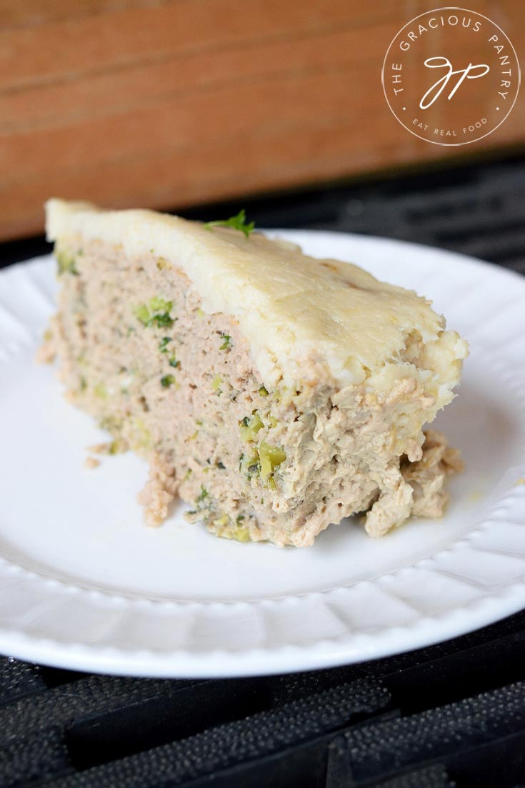 Clean Eating Turkey Vegetable Meatloaf Casserole recipe sliced and placed on a white plate.
