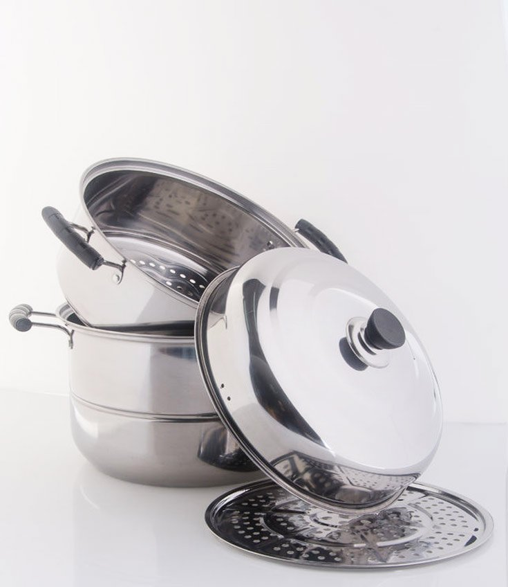 An image of a steamer pot sitting with it's lid off in this guide on how to steam vegetables