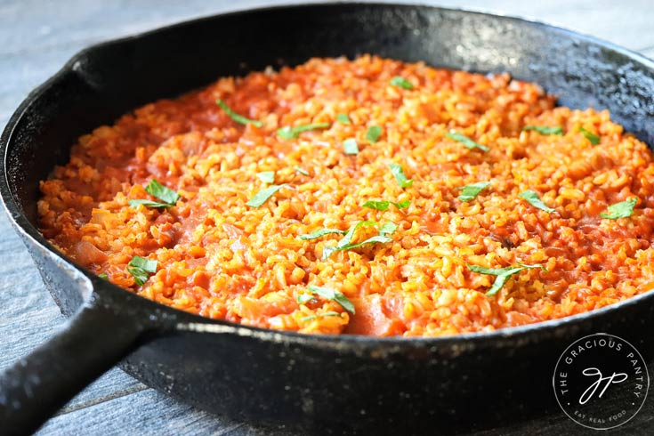 A view from the side of the skillet shows this Clean Eating Salsa Rice up close.