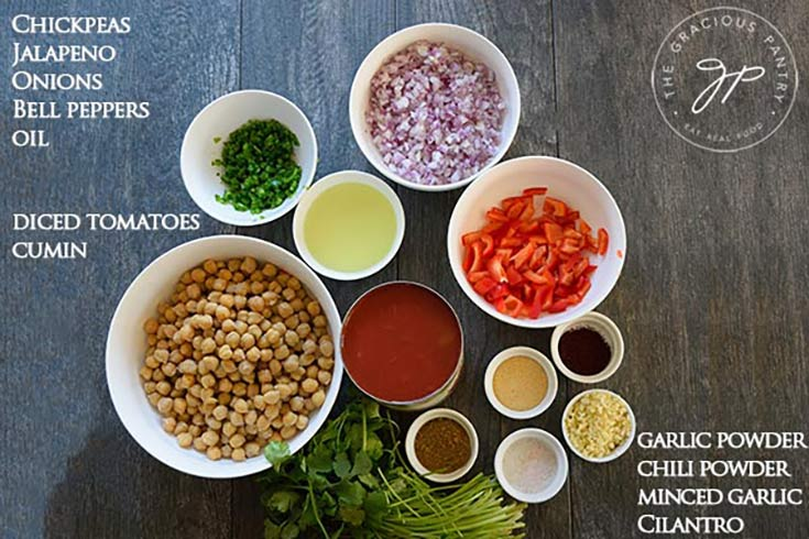 The Mise En Place for this Clean Eating Mexican Chickpea Stew Recipe shows all the ingredients required for this recipe grouped together in individual bowls.
