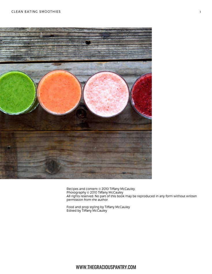 A view of the inside credit page in this Clean Eating Smoothies eCookbook. It shows blended smoothies of different colors sitting in a row on a wooden table.