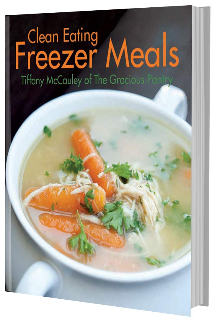 This image shows the cover of this Clean Eating Freezer Meals Cookbook