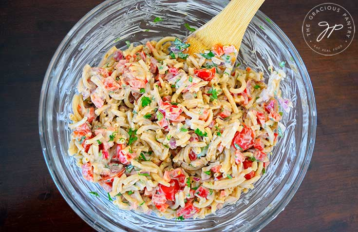 An overview shot of this clean eating easy macaroni salad recipe, looking down into the bowl at this colorful dish.