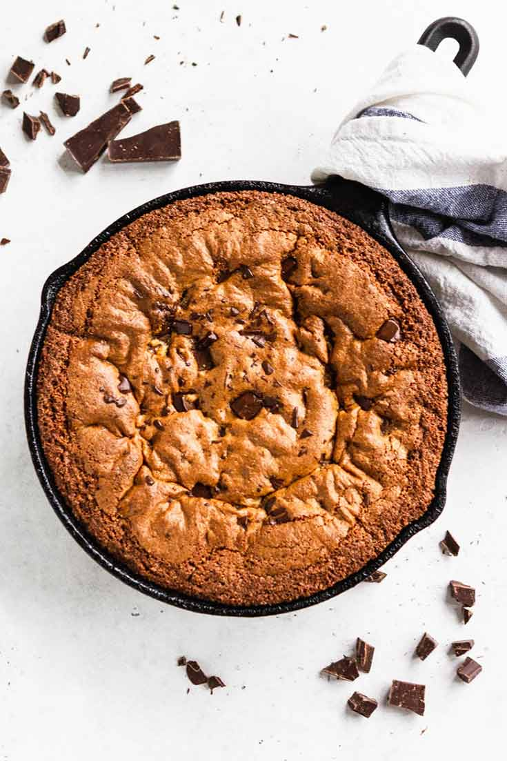 And overhead shot shows this Clean Eating Skillet Chocolate Chip Cookie just baked and waiting for some ice cream and a spoon.
