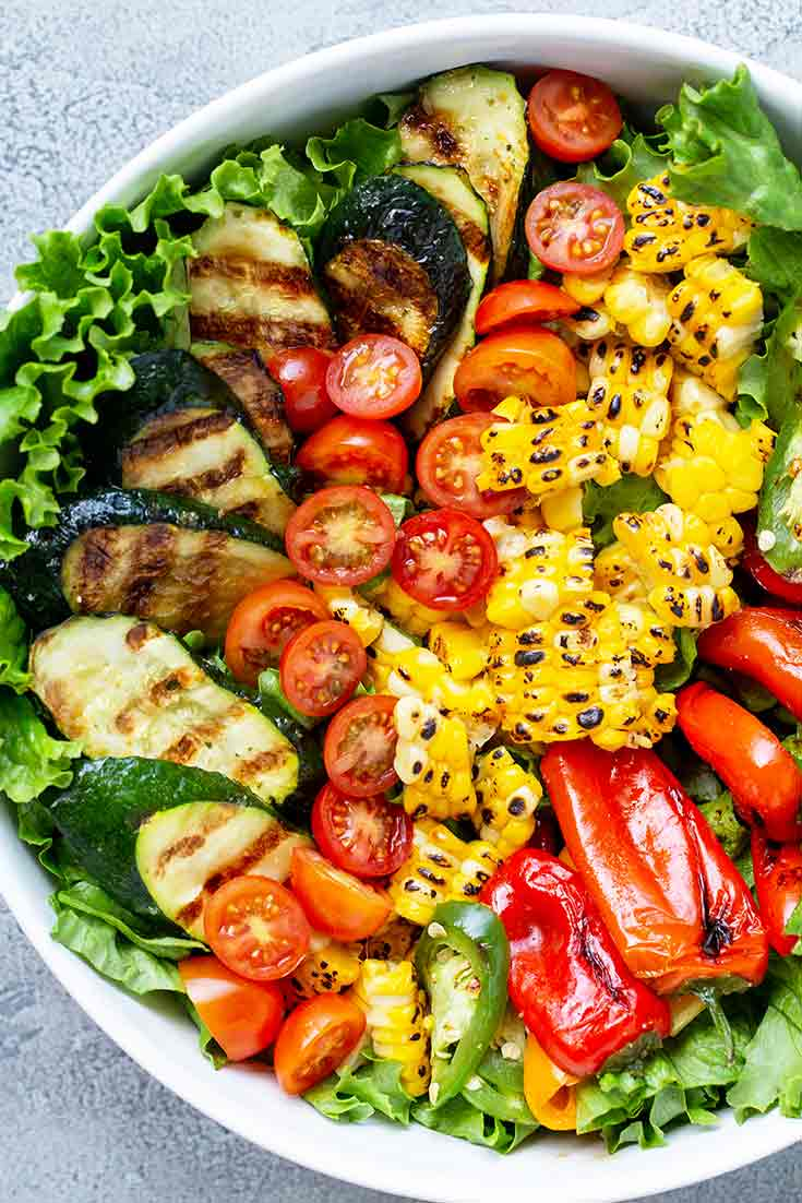 An overhead shot looking down into this beautiful bowl of Clean Eating Grilled Garden Salad. The colors are like a grilled veggie rainbow!