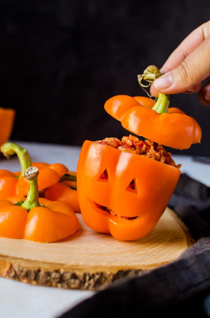 Halloween stuffed peppers carved like Jack O Lanterns