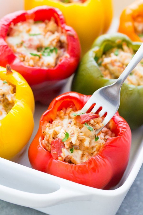 ground turkey stuffed peppers in white casserole dish