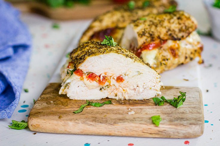 Garnish this finished Air Fryer Chicken Breast Recipe with fresh basil, cut and serve.
