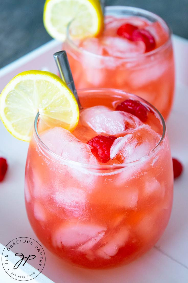 A closeup view of the glasses of raspberry lemonade, focusing on the glass in front.