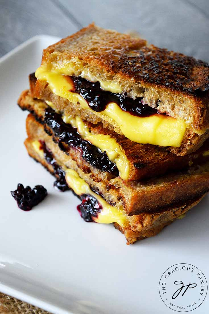 This Grilled Cheese Sandwich Recipe With Blackberries offers delicious, melty cheese with ooey-gooey blackberry compote. A heady and delicious combination!